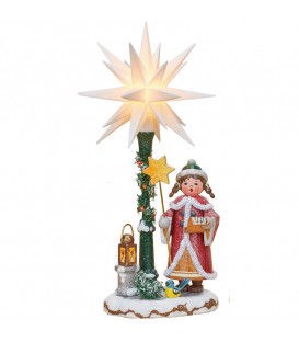 Village de Noël miniature, fillette chantant sous étoile de Noël