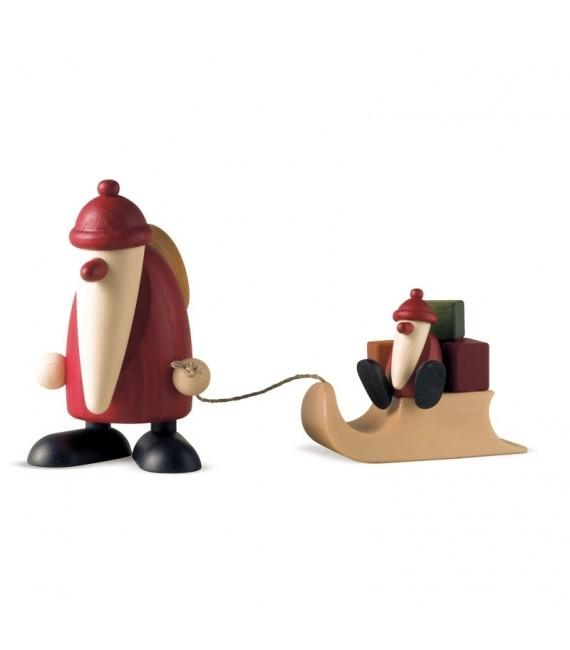 Père Noël en bois et enfant sur luge
