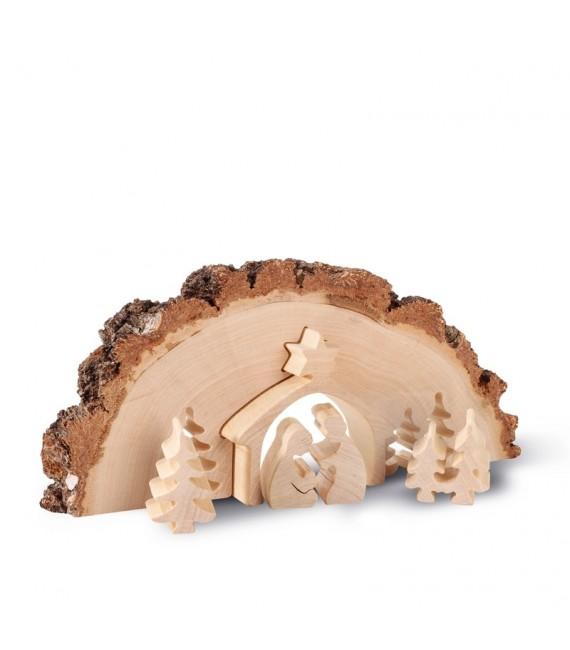 Crèche de Noel en bois ciselé dans un tronc d'arbre