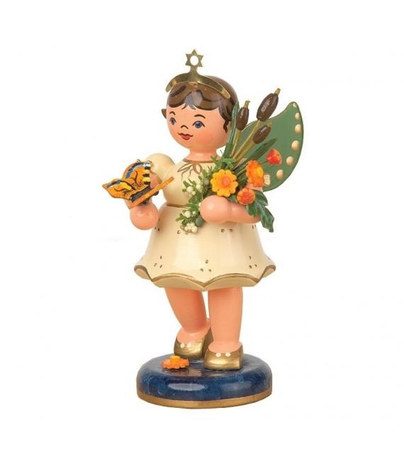 Figurine ange de Noël et bouquet de fleurs