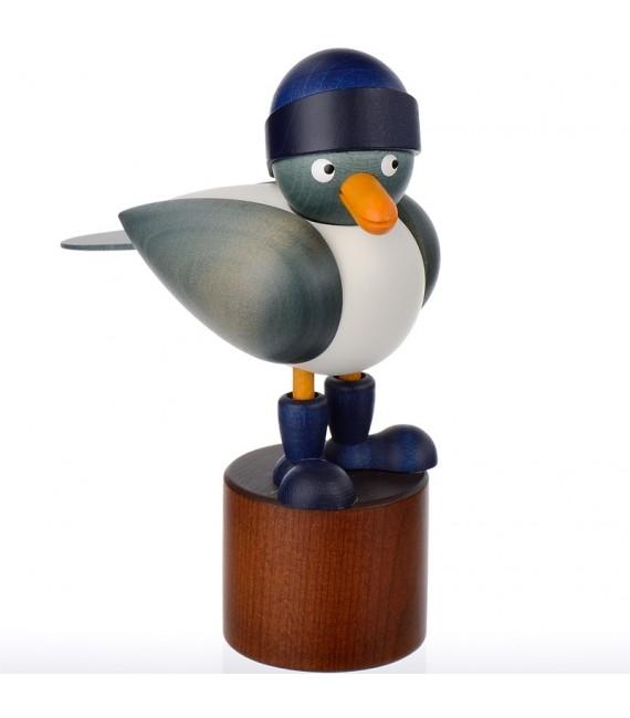 Jolie mouette en bois avec un bonnet bleu