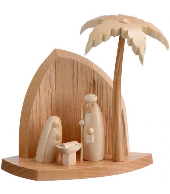 Crèche en bois avec un palmier et la nativité