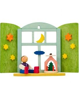 Décoration de sapin de Noël, enfant et manège devant fenêtre