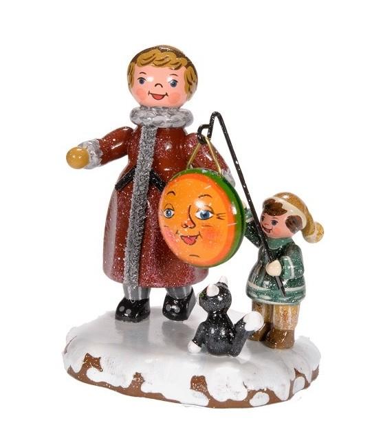 Village de Noël miniature, maman et fillette