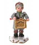 Village de Noël miniature, joueur d'harmonium