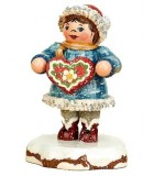 Village de Noël miniature, fillette et gâteau