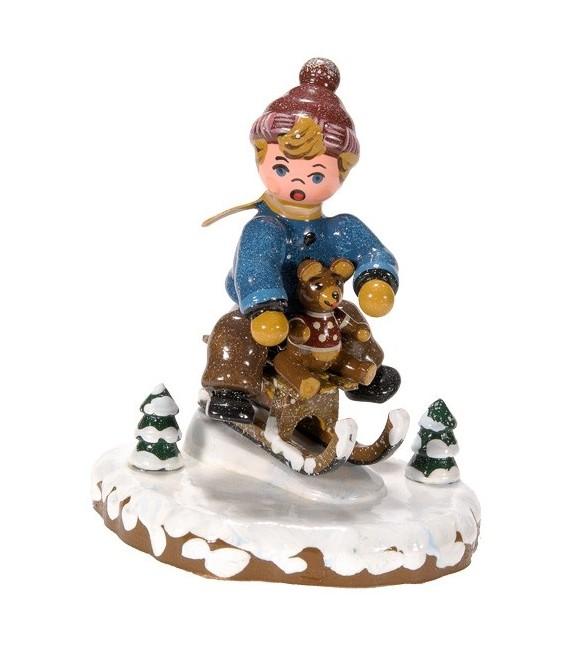 Village de Noël miniature, garçon sur la luge