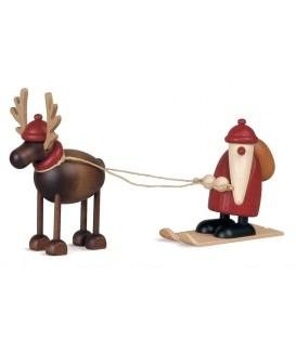 Père Noël en bois sur ski et renne