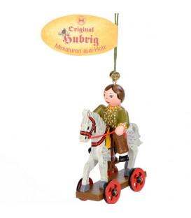 Décoration sapin de Noël vintage, enfant sur un cheval de bois,