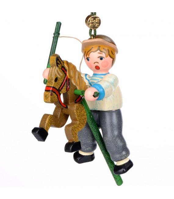 Noël d'autrefois, petit garcon sur un cheval en bois