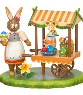 Lapin de Pâques en bois vendeuse d'oeufs