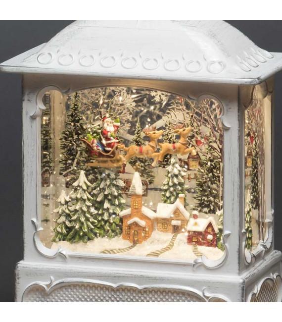 Lanterne de Noël blanche, père Noël volant au-dessus d'un village